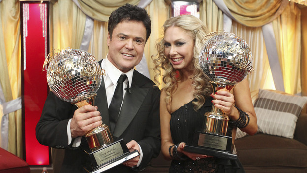 Donny & Kym with their Mirror Ball Trophies